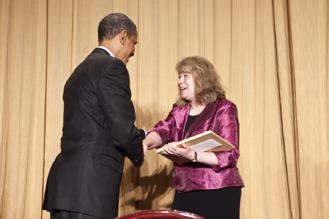 2010 Edgar A. Poe recipient Sandy Kleffman is congratulated by President Barack Obama. (photo/ Paul Morse)